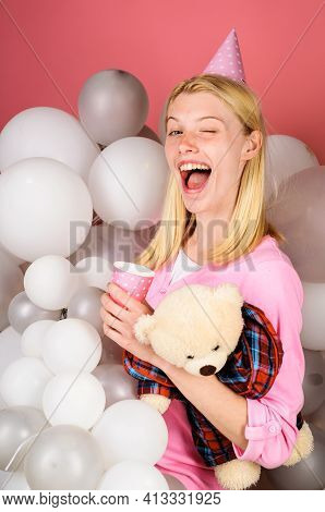 Happy Woman In Party Hat Celebrate Birthday. Winking Girl In Pajama Celebrate Pajama Party.