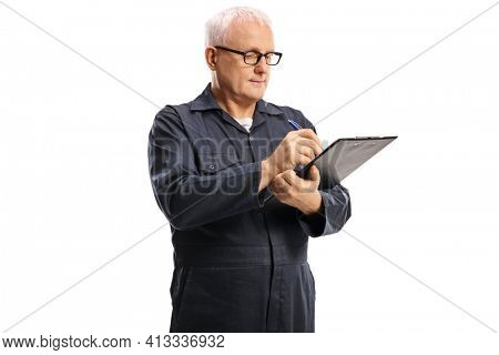 Worker in an overall uniform writing a document isolated on white background