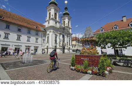 Graz,austria-july 07, 2020: The Famous Clock Tower, One Of The City Main Attractions, Made Of Flower