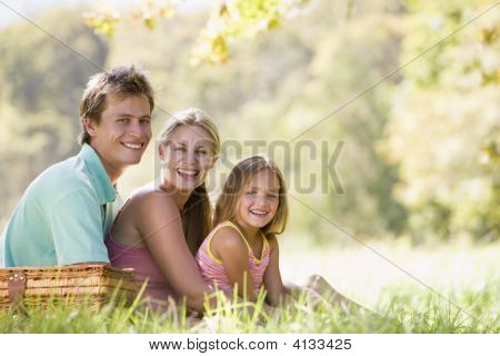 Families At Park Having A Picnic And Smiling