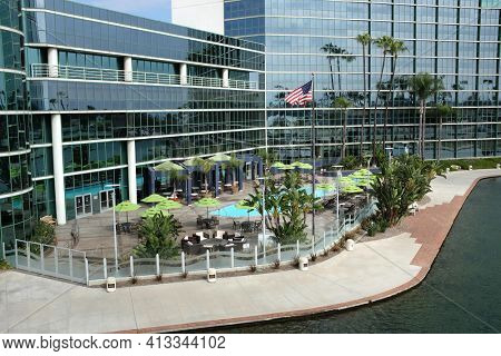 LONG BEACH, CA - FEBRUARY 21, 2015: Hyatt Regency Hotel pool area. Adjacent to the Long Beach Convention and Entertainment Center the hotel has ocean views in an urban setting.