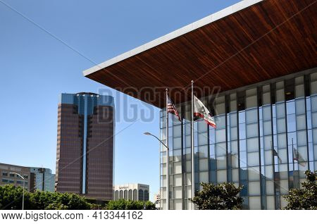 LONG BEACH, CALIF - SEPT 10, 2018: Detail of the Governor George Deukmejian Courthouse with One World Trade Center in downtown Long Beach.