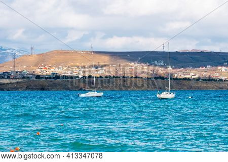 Tbilisi Sea And Boat With Deflated Sails