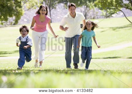 Families Running Outdoors Smiling