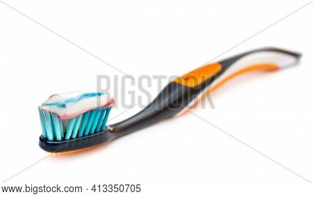 Toothbrush With Toothpaste On A White Background.