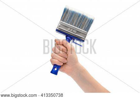 Woman's Hand Holding Paintbrush. Isolated On White Background.