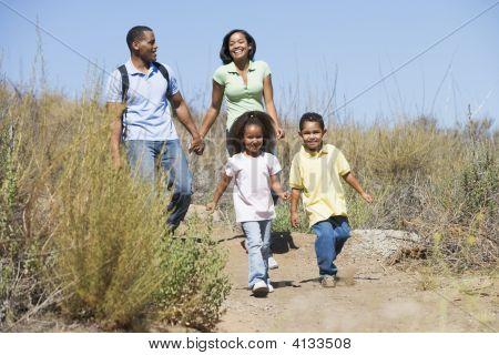 Families Walking On Path Holding Hands And Smiling