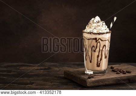 Cold Frappe Coffee  With Whipped Cream. Mudslide Delicious Iced Coffee Drink, Copy Space.