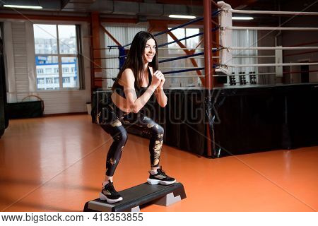 A Beautiful Young Woman In A Sports Club. Doing Health Exercises.