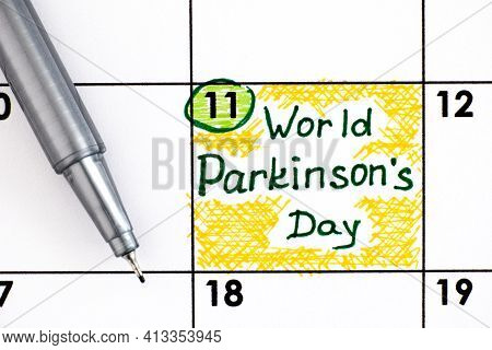 Reminder World Parkinson's Day In Calendar With Pen. April 11