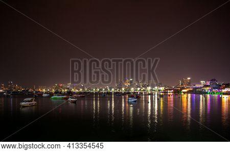 Pattaya, Thailand- January 16,2019: Ships And Ferries In Pattaya City Marina Bay At Night With The C