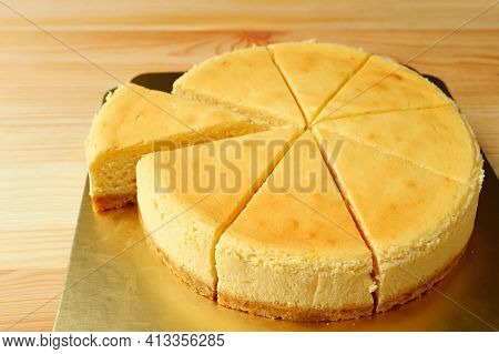 Delectable Creamy Baked Cheesecake With A Slice Cut From Whole Cake