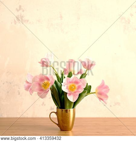 Summer Vibes And Mood Image Of Bouquet Of Pink Tulips In Golden Cup On Table