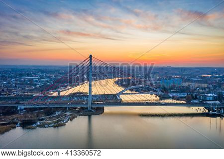 Cable-stayed bridge on the Vistula river in Gdansk at sunrise. Poland