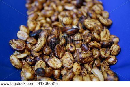 Closeup Of Heap Of Yellow Honey Process Coffee Beans