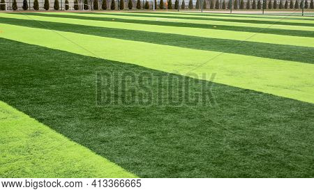 Artificial Green Grass On A Professional Soccer Field. Outdoor Artificial Soccer Field Awaiting Play