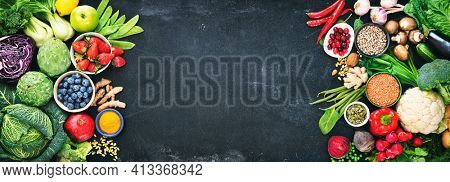 Healthy food selection with fruits, vegetables, seeds, superfood, cereals on dark background