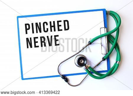 Pinched Nerve Text On Medical Folder With Documents And Stethoscope On White Background. Medical Con