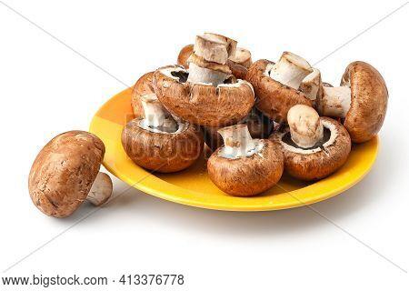 Raw Mushrooms Champignons. Brown Wet Mushrooms On Yellow Plate. Bunch Of Fresh Champignons. Natural
