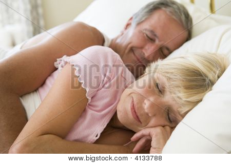 Couples Lying In Bed Sleeping