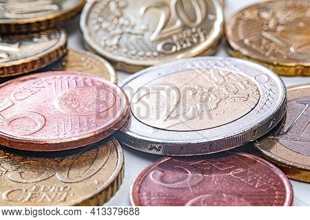 A Bunch Of Euro Coins. A Five-cent Piece. Yellow Twenty-cent Euro Coin, Isolated On A White Backgrou