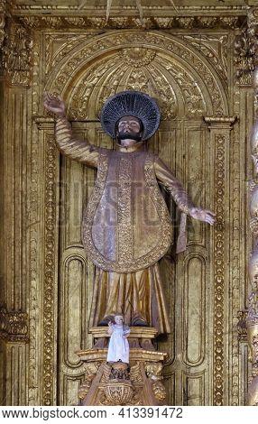 OLD GOA, INDIA - FEBRUARY 18, 2020: Saint Francis Xavier statue on the High altar in the Basilica Bom Jesus, Old Goa, Velha Goa, Goa, India