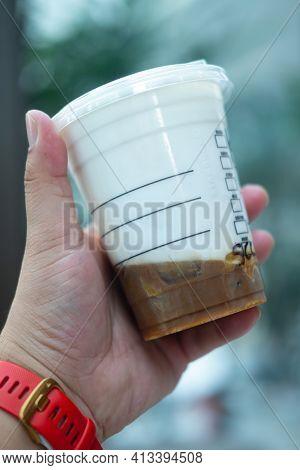 Bangkok, Thailand - March 20, 2021: Starbucks Iced Salted Caramel Cloud Macchiato. Espresso Shot Pou