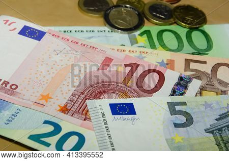 Euro Banknotes In Denominations Of Five, Ten, Twenty, Fifty, One Hundred And Euro Coins. European Cu