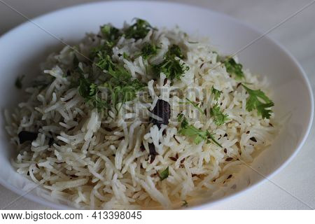 Steamed Basmati Rice Flavoured With Cumin And Spices. Locally Known As Jeera Rice.