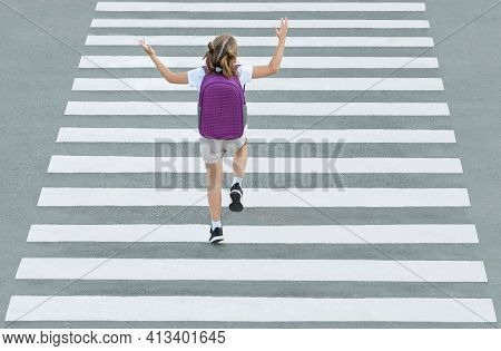 Stylish Young Teen Girl Walking With Backpack. Active Child. Kid Runs Across The Crosswalk. A School