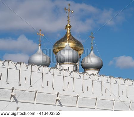 Domes Of The Smolensk Cathedral On The White Defensive Wall Of The Novodevichy Convent Against The B