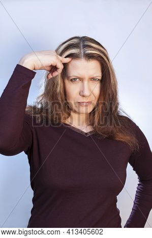 A Beautiful Woman Shows A Finger On Her Hair, Which Soon Becomes Gray. She Is Sorry For Her Gray Hai