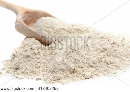 Wheat Flour. Flour Close-up. An Ingredient For Baking Bread And Rolls. Scoop With Flour