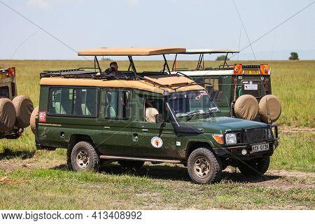 Maasai Mara, Kenya  January 29, 2021: Safari Car Toyota Land Cruiser 70 In A Savanna.