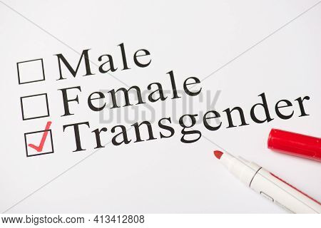 Above Photo Of Red Color Marker And Paper With Text Male Female And Transgender Isolated On The Whit