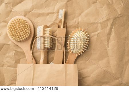 Top View Photo Of Natural Wooden Bodycare And Hair Brushes In Recycling Paper Bag On Isolated Crumpl
