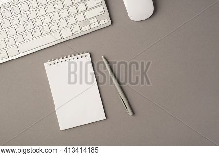 Above Photo Of Keyboard Computer Mouse Empty Notebook And Pen Isolated On The Grey Background With E