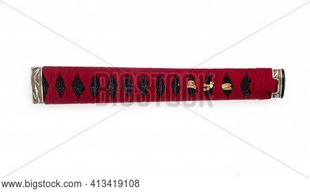 Handle Of Samurai Katana Japanese Sword. Handmade Tsuka With Red Wicker Ornament Isolated On A White