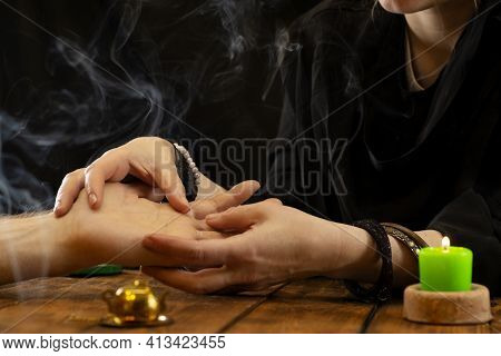 A Fortune Teller Or Oracle In Search Of The Lines Of Fate In The Palm Of A Person. Fortune Telling B