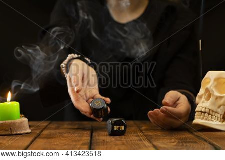 A Fortune Teller Or Oracle Throws Black Dice, Predicting The Future, A Good Deal. Psychic Readings A