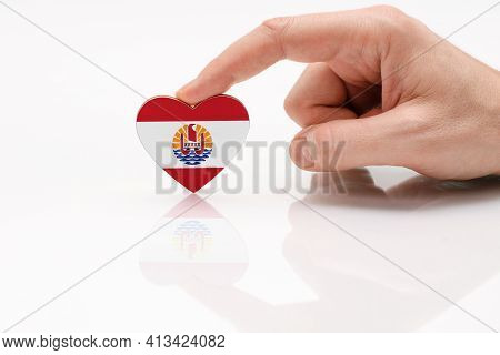 Flag Of French Polynesia. Love And Respect Polynesia. A Man's Hand Holds A Heart In The Shape Of The