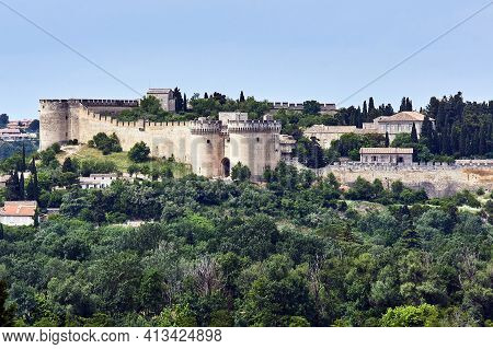 Stone Walls And Towers Of The Medieval Castle  In The City Of Avignon In France