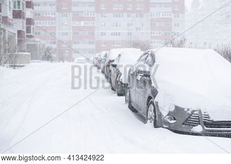 A Some Cars Covered Under Snow During Winter, Stormy Weather Outside