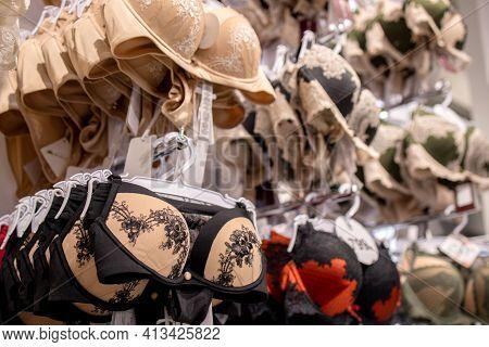 Row Of Bras In Underwear Shop. Modern And Fashionable Interior Of Underwear Shop