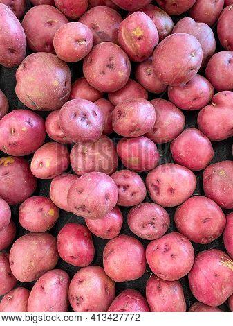 Red Potato Pile At Farmers Market Fresh Potatoes Organic Vegetable Food Background
