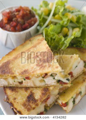 Quesadillas With Cajun Chicken Cheese Tomato Salsa And Corn Salad