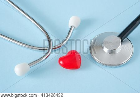 Heart And Stethoscope On Blue Background. Heart Health, Health Care, Cardiology Concept.