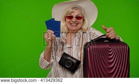 Air Flight Journey. Traveler Tourist Senior Woman Celebrating, Holding Passport, Tickets, Luggage. C