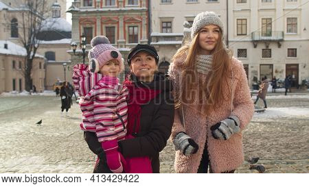 Lovely Sisters Couple With Younger Sister Child Girl Walking In City, Talking With Smiles Outdoor. T