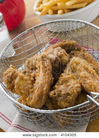 Southern Fried Chicken In A Basket With Fries